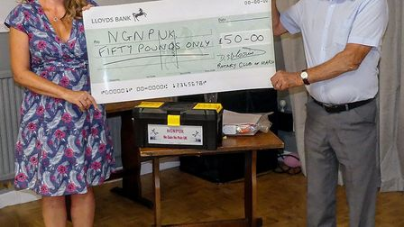 Louise Nicholls was presented with a donation by senior vice president George Russell. PHOTO: March
