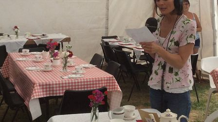 BBC Radio Norfolk's Julie Reinger reading clue two for treasure quest in Upwell. PHOTO: Ros Shorting