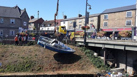 A boat is removed from the River Nene in March