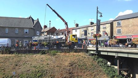 A boat that had been lived in by a homeless man is uplled out of the River Nene in March. PHOTO: Kat
