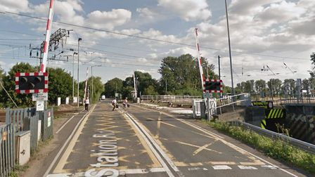 A vehicle has crashed and caused damage to Ely's North level crossing after hitting the barriers and