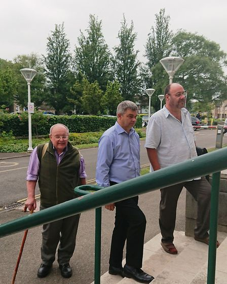 Mike Mason (left), Rob Skoulding and Dave Humprhey arrive at Shire Hall, Cambridge, today to be show