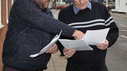 Taxi drivers protest March. Left: Dave Humphrey with Cllr Dave Patrick looking at the facts and fig