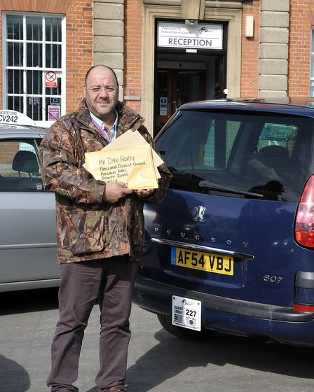Taxi driver Dave Humphrey delivering grant forms to Fenland Hall.