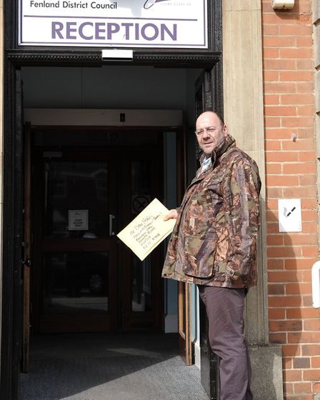Taxi driver Dave Humphrey dropping of grant forms at Fenland Hall.