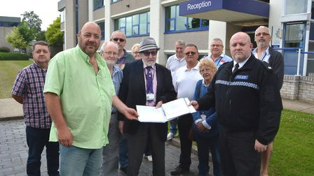 Coach and taxi firms protest outside Cambs Police headquarters as pressure mounts to investigate com