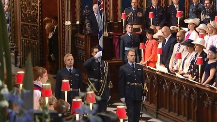 Flying officer Alex Ogden (left) escorted the Royal Air Force Ensign down the aisle as part of The C