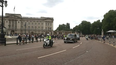 Thousands of people gathered outside Buckingham Palace to watch a flypast of aircraft to mark the ce