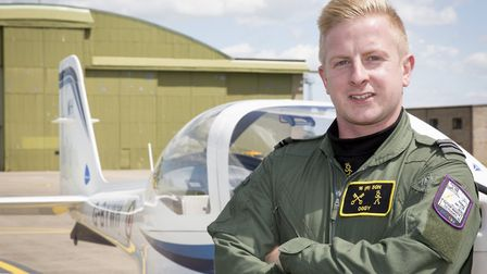 The first trainee pilot to land at RAF Wittering's reopened airfield in April 2014 has graduated fr