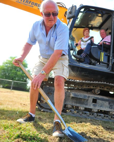 Councillor Kit Owen pictured cutting the first sod - Work has started at Estover playing fields in M