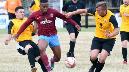 Luke Cable and Callum Madigan attempt to stop a Deeping player during March Town's friendly last Sat