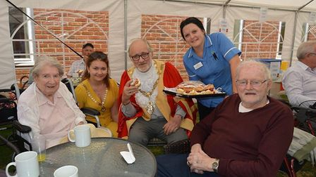 Residents enjoy the summer fete celebrations at Lily House. Jean Brown, senior care assistant Cheryl