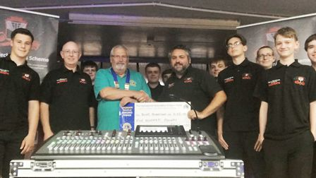 President Steve Palmer presented a cheque for £500 to founder Pino Soccio of Young Technicians. PHOT