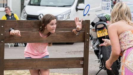 One of the sidestalls, a ring is thrown to a girl in the stocks