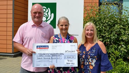 Mark and Kim Cross donate charity money to oncologist Dr Kim McAdam at Peterborough City Hospital. P