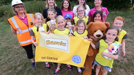 1st Coates Brownies at their teddy bears picnic event with the packs new flag, provided by Whittlese