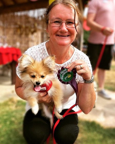 Ann Drennan and Gizmo are among contestants in the Aria Court dog show. PHOTO: Aria Court