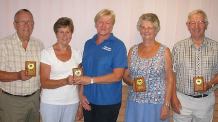 The title-winning Livewires team, receiving their trophies from Claire Norton (centre) are David Lon