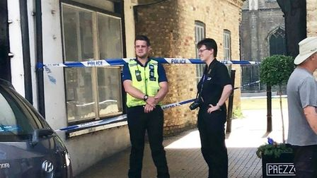 Police on guard outside Ely Cathedral following the alleged rape last month. Photo: John Elworthy