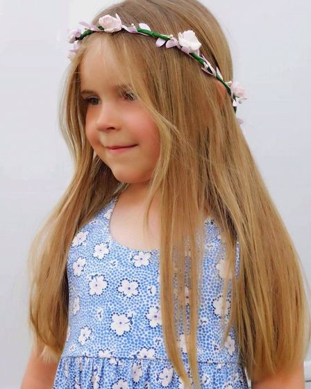 Amy Fisher, 4, had her elbow length hair cut for charity. She hopes to raise more than £300. Photo: