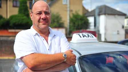 Dave Humphrey pictured with his taxi in March. Picture: HARRY RUTTER