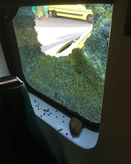 Police are appealing for information after a large rock was launched through the window of an ambula