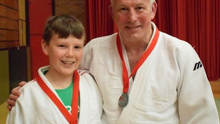 Yonas and judo legend Darren Dean with their medals