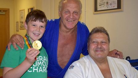 Yonas wears Olympic gold with Olympic Judo Medalists Brian Jacks and Angelo Parisi