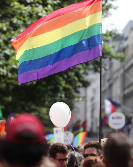 A pride flag is held up during the Pride in London Parade in central London. Picture: Jonathan Brady