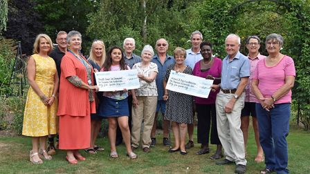 Wisbech St Marys gardeners proudly hand over two cheques to charity. Photo: Submitted