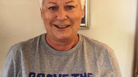 Jean Livett braves the shave to raise money for Macmillan cancer charity. The shave is carried out a