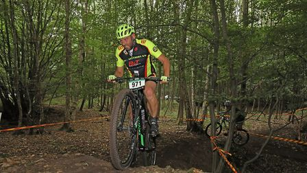 Martin Holland of Ely Cyclling Club keeping ahead of Paul Harbinson to finish 18th in the Mud, Sweat