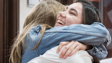 Helena Romanes student Karolina Daszewska is congratulated after finding out she had gained a B in P