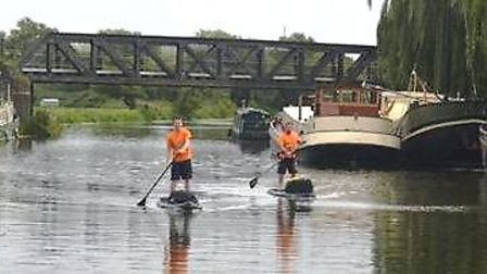 Justin Miles and Christian Bumke, who are paddleboarding from Cambridge to King's Lynn in aid of Mag