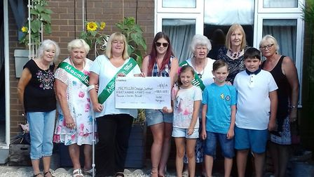 Last week Jade was joined by Community Chest members to present the cheque of £887 to Macmillan repr