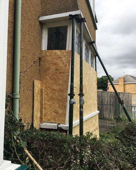 A man loses control of a stolen car and smashes through two gardens, ending up crashing into the fro