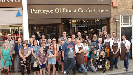 Staff, customers and owner David Learner gathered for an end-of-term photo as the beloved High Stree