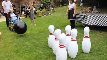 Gwen Wilson enjoys a game of skittles at her 100th birthday party at the Gables Care Home in Chatter