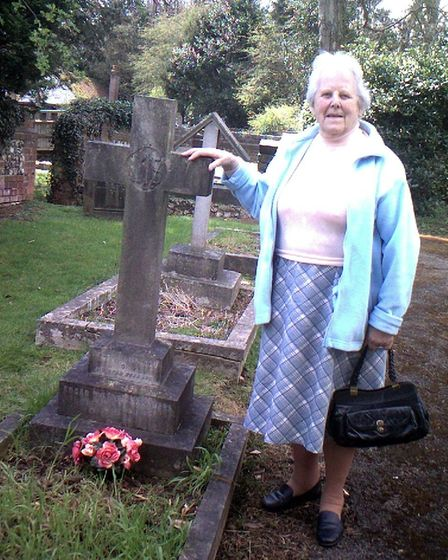 Joyce Saunders at the grave of her father in Radlett, Hertfordshire.