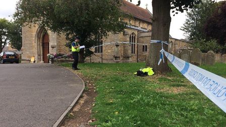 Police have cornered off Chatteris Parish Church after human bones were discovered near a pathway in