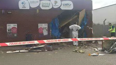 Aftermath of the ram raid at Eaton Socon, Cambridgeshire, today; the raiders fled in a white Mercede