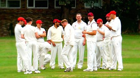City of Ely players celebrate a wicket during their win against Isleham. Picture: SIMON CROSS