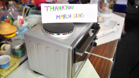 Members of March Lions Club donated money to buy cooking equipment for service users at Eddie's to '