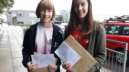 GCSE Results Day 2018: Millie and Georgia Clarke at Neale-Wade Academy with their grades. Picture: K