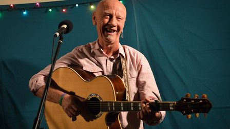 Kevin Dempsey performs at Under The Bridge annoual acoustic concert in March Town Hall.
