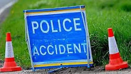 A woman was left trapped inside her car following a two-vehicle crash in Whittlesey.
