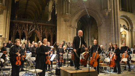 Steve Bingham with Ely Sinfonia during the concert at Ely Cathedral. Photo: MIKE ROUSE.