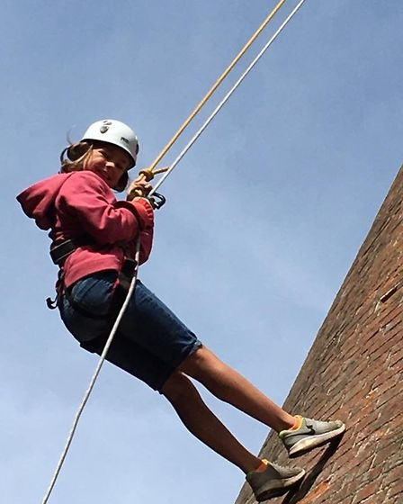 Brave youngsters from a Fenland scout group got to climb up and abseil from the top of the highest t