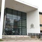 A Wilburton man accused of sexually assaulting three schoolgirls covered his ears with his hands whe