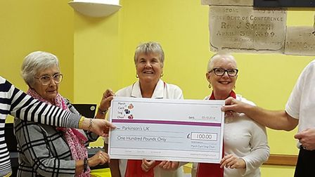 Members of March Cant Sing Choir Committee presented Parkinsons March Group with a cheque for 100. P